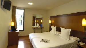 Hotel Del Comte bedroom